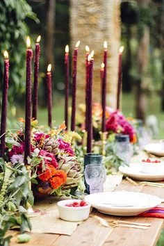purple oxblood taper candles + artichokes, green and pink and orange flowers // fun, fresh and elegant table setting // so beautiful