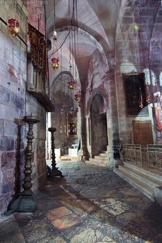 12-One of many hoary passageways and dusty halls within the Holy Sepulchre Church.