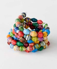 Wrap your wrists in love! Each bead is handcrafted from recycled paper and then strung on memory wire to create a multi-level look.  Handmade by African Style, a group that Noonday Collection helped launch in Uganda.