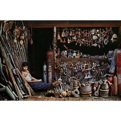 I photographed this young shopkeeper in Cambodia selling secondhand tools, pipes, levers, bolts and spare parts. Shops like these are disappearing because used and broken objects are commonly discarded in favor of buying new ones.