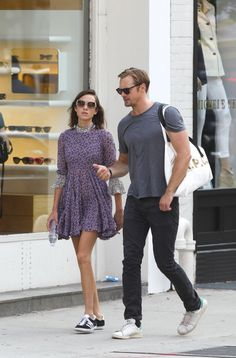 Alexa Chung & bf Alex Skarsgard Jul15. Topshop Unique silk floral dress with Adidas trainers.