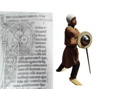 nachgestellte Szene aus einem Manuskript, genauer gesagt einer Abbildung auf fol. 276v des Charleville-Mèzières MS.255 Bible von 1251-1300, Frankreich. Ich habe die Hut erst als Schutzen-wariation interpretiert, doch inzwischen bin ich der meinung das es sich um den unteren Scützen handelt.