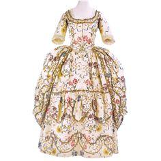 """Vestido """"à la Polonaise"""" 1776-1780 Vestido en sarga de seda brocada sobre fondo color crema, con motivos florales policromos"""