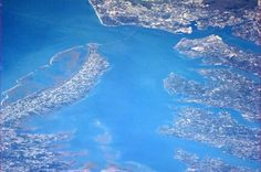 follow an astronaut on tumblr {facebook & twitter too} to see his amazing photos taken from space. This one is: Back on the East Coast, the Chesapeake Bay from orbit. You can even see the causeway.