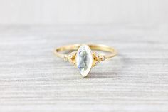 Marquise moonstone and diamond engagement ring in gold or