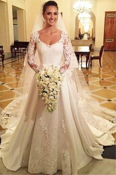 A-line Satin Long Sleeves Buttons Lace Chapel Train Wedding Dress  http://www.shedressing.com/