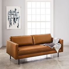 We designed our Axel Leather Sofa with clean lines in mind. It features your choice of leather on a simple industrial form, with bench cushioning, flanged edges and modern metal legs. Though intended for your living room, its kiln-dried, Contract … 1950s Furniture, Furniture Catalog, Sofa Furniture, Living Room Furniture, Furniture Design, Metal Furniture, Living Rooms, Living Spaces, Furniture Stores