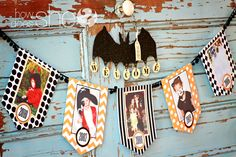 FREE exclusive SpOOky Banner! It has spaces to put photos of your family's halloween costumes from past years! Genius!