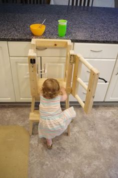 kids furniture Once my daughter started walking around, we wanted to get her a Kitchen Helper Tower (also referred to as a Learning Tower) so she could be at counter height and. Toddler Kitchen Stool, Diy Kids Kitchen, Kitchen Stools, Kitchen Decor, Diy Karton, Learning Tower, Diy Stool, Kitchen Helper, Kids Furniture