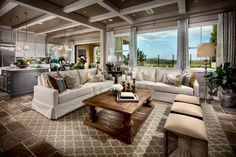 A dramatic coffered ceiling echoes the colors in this elegant space. The Helena, a new home by Toll Brothers at Terraces at Baker Ranch. Lake Forest, CA. Outdoor Furniture Sets, Home Interior Design, New Homes, Lounge Areas, Luxury Homes, Home, Family Room, Great Rooms, Living Room Designs