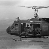 """US Army Bell UH-1 Iroquois or """"Huey"""" helicopter in flight"""