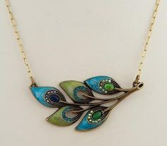 """Peacock Feather Necklace. Set in Antique Gold American Lead Free Pewter accented with Turquoise, Pacific Opal, Amethyst Aurora Borealis, Peridot Aurora Borealis, and Blue Zircon Swarovski crystals and Peacock Blue and Olive Hand-painted enamel. 16"""" Long with a 3"""" extension."""