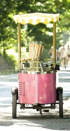 A gelato cart in Italy (those are cones, not bread, that are stacked high like that)!