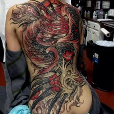 #Phoenix back #tattoo. The dark red shading really makes this one pop.