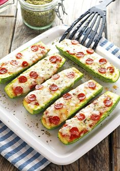 Zucchini Pizza Boats ~ if you're craving pizza but not the carbs, these are definitely the answer . Zucchini Pizza Boats ~ if you're craving pizza but not the carbs, these are definitely the answer . Zucchini Pizza Happen, Zucchini Pizza Boats, Zucchini Boat Recipes, Stuffed Zucchini Recipes, Stuffed Zucchini Boats, Zuchinni Pizza Crust, Baked Zuchinni Recipes, Zucchini Bites, Mexican Food Recipes