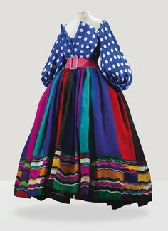 CHRISTIAN LACROIX HAUTE COUTURE, S/S 1998 A FINE EVENING ENSEMBLE: GAUZE BLOUSE OF BLUE AND WHITE POLKA DOTS WITH BOLDLY STRIPED GAZAR SKIRT AND PINK BELT, MODEL 'CARAMBA'