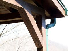 """After a quick consultation with an engineer, I learned that the central column of the covered deck space wasn't necessary for structural support. In order to remove it properly, custom braces were mitered from 6x6"""" lumber, and installed on each end of the frontal joist using heavy duty bolts. This added necessary reinforcement from above, allowing the column to be removed completely."""