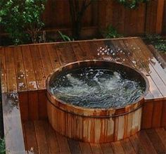 Google Image Result for http://www.hot-tubs-spas-swimming-pools.com/images/japanese-wooden-tub.jpg