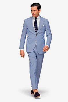 Great suit from Suitsupply.com. Love the combination of the light blue linen suit and the navy knit tie.