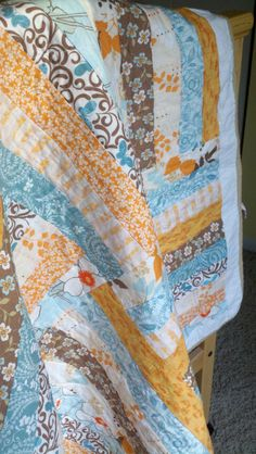 Orange and turquoise quilt