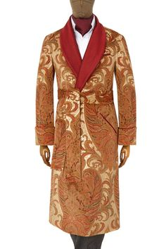 <p><p>This beautifully constructed gown shows off not only the skills of its maker but also those of the velvet printer. The rich patterns within the fabric are rendered with such precision that it gives a real depth to the whole design. This is then punctuated with the quilted shawl collar. It is fully lined in a sandy gold satin and piped throughout in the deep red of the design. A piece for the true clothing aficionado<p><p>.As with all our gowns, they are handmade in England, using…