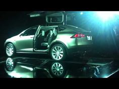 Tesla unveils new SUV prototype w/falcon-wing doors (i.e. gullwing, go to 3:20 to see), 300 mile range, faster than a Porsche, all-electric.