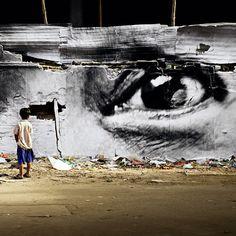 "Instalação fotográfica ""Women are Heroes"", do artista francês JR, no Camboja. #artes #arts #art #arte #impacto #artederua #arteurbana #mural #pinturamural #streetart #urbanart #design #architecturelover  #architecture #arquitetura #projetocompartilhar #davidguerra #photography #fotografia #shareproject #womenareheroes #jr #jrfotografia #jrphotography #camboja #cambodia"