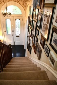 I love a stair wall filled with family pictures:) it really makes the house a home!