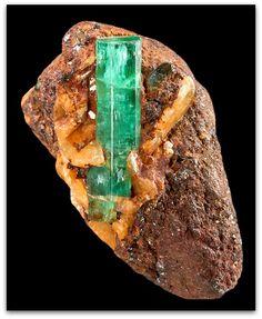 Beryl var. Emerald crystals perched on hard matrix
