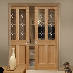 Double Pocket River Oak Churnet 2 Pane Oak sliding door system in three size widths with Leaded clear glass. #diamondglassdoors #pocketdoors #oakglazedpocketdoors