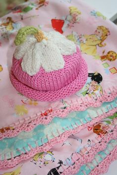 "Posted by Sewn with Grace: ""A friend of mine is going to be a first time Grandma and I get to attend a shower for the new Mama this weekend.  I had a lot of fun making a receiving blanket from a yard of cotton and a yard of flannel.  I crocheted the edge using the tutorial on You Go Girl.  The hat is knit from a pattern in the book, ""Itty Bitty Hats"" by Susan B. Anderson.  It's just a wee thing, newborn size."""