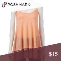 Lace spaghetti strap top This is a beautiful peach color top with lace detailing. It is a SMALL but it is very big. Can fit a large or even XL depends on your style. It's meant to be oversized but it doesn't have to be. Freshman Tops Tank Tops