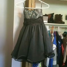Black dress Poofy skirt with a short fit to it. Black sparkles along the top on a silver background. Worn once for homecoming and never again. Speechless Dresses Strapless