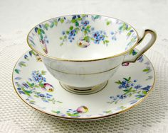 Vintage Tea Cup and Saucer with Hand Painted Flowers by TheAcreage                                                                                                                                                     More