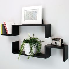 "Features:  -Set includes 2 ""S"" shaped wall floating shelves.  -Easy to hang using keyholes on the back.  -Hanging hardware included.  -Free standing: Yes.  -Shelves can be painted: Yes.  -Recommended"