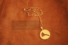 Eritrea map silhouette necklace; gold plated. Unisex. Complete your outfit with this piece for casual wear, festivals, etc. *coin for comparison of size