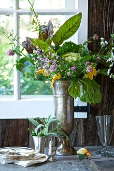 Kale leaves, wildflowers, and other goodies from the garden create a rich bouquet.