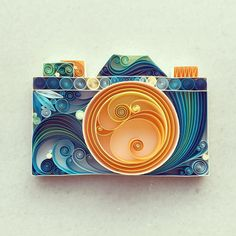 Colorful paper quilled to make decorative sculptures
