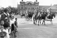 A South Korean cavalry regiment make their way to Taegu Station, on their way to the front line of the Korean War, September (Photo by Bert Hardy) North Korea Tour, Korean Peninsula, Become A Photographer, The Blitz, Korean Traditional, Korean War, History Photos, Soviet Union, Armed Forces