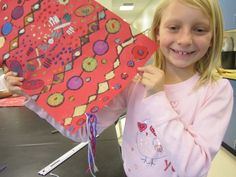 Second grade Middle East carpets. Cardboard printing with tempera, color with oil pastel, tie yarn for fringe.