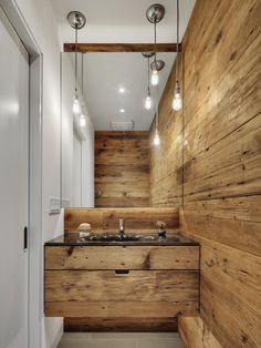 + | Powder room with reclaimed wood walls by Blender Architecture