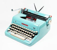Vintage 1955 Turquoise Quiet De Luxe Manual by BMTvintage on Etsy, $425.00    I want this.