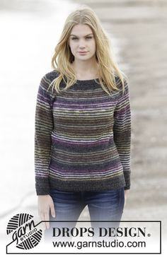 "Frosty Morning - Knitted DROPS fitted jumper with stripes, lace pattern, raglan and round yoke in ""Delight"" and ""Alpaca"". Size: S - XXXL. - Free pattern by DROPS Design"