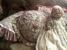 Pretty lace pillows and vintage doll