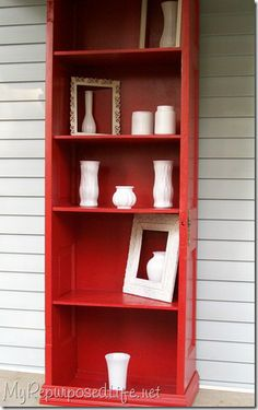 Can't see very well, but this is a door cut in half, used as the sides of this book case, with molding around the base, and shelves added.