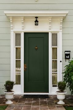 It's too trendy for such a commitment but how awesome would a mint grey exterior be with a hunter green door??