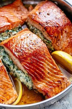 Creamy Spinach Stuffed Salmon in garlic butter is a new delicious way to enjoy salmon! Filled with cream cheese, spinach, parmesan cheese and garlic, this salmon beats than anything found in a restaurant. Your new favourite salmon recipe includes pan frie Salmon Dishes, Fish Dishes, Seafood Dishes, Fish Recipes, Seafood Recipes, Cooking Recipes, Healthy Recipes, Healthy Ramadan Recipes, Whole30 Recipes