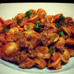 Orecchiette Bolognese  ground beef, ground pork, crushed tomatoes, tomato paste, rosemary, thyme and a little cream!  Excellent!