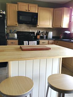 DIY Kitchen Island - Stock unfinished cabinets, beadboard, paint and butcher block counter