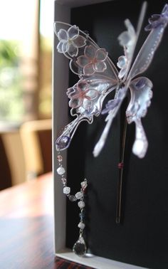 DIY Idea: Plastic Clear PET Bottle Wings attached into a wired Butterfly Shape. ..and decorated with shiny beads...Sakura!